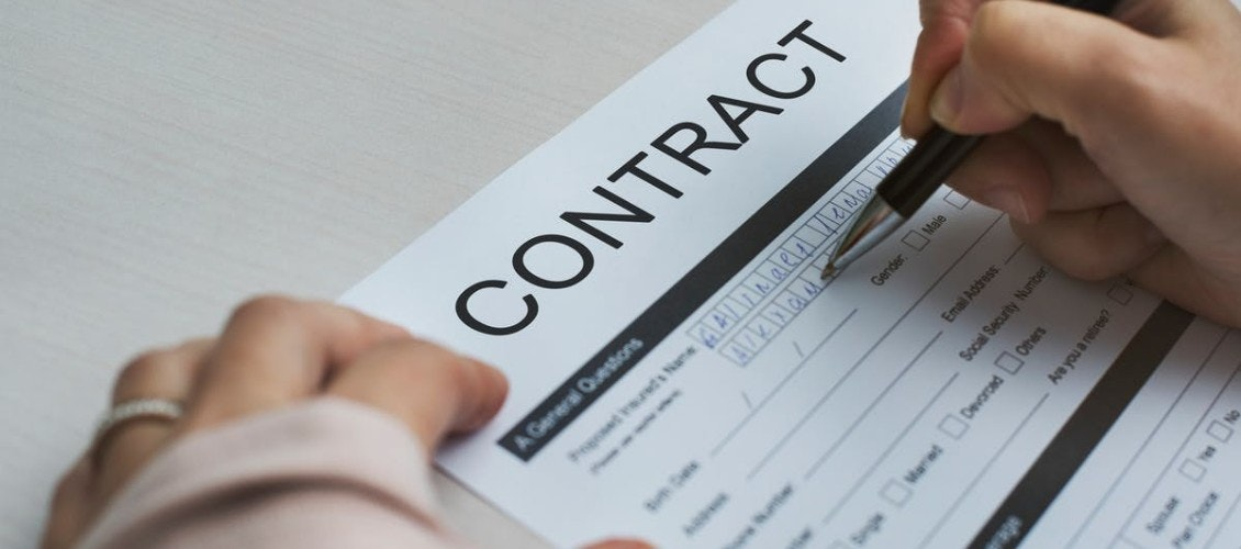employee-signing-contract