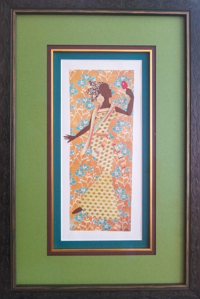 Framed paper art. Woman holding a red bird