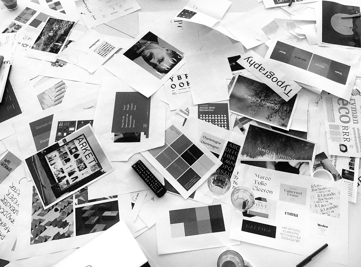 Black and white process picture of papers on the ground