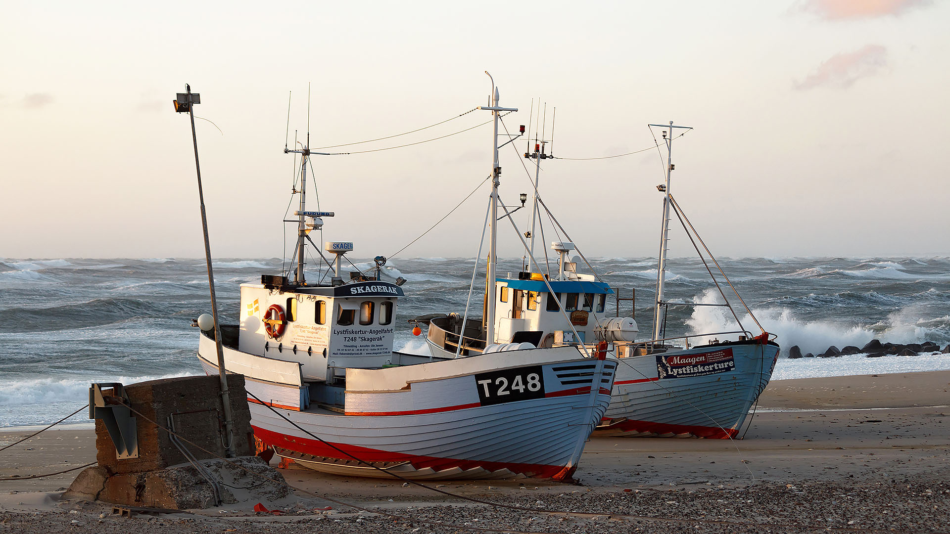 Two beached fishing vessels