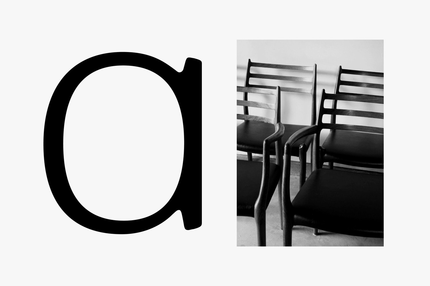 bespoke letter 'a' in black writing and black and white image of chairs