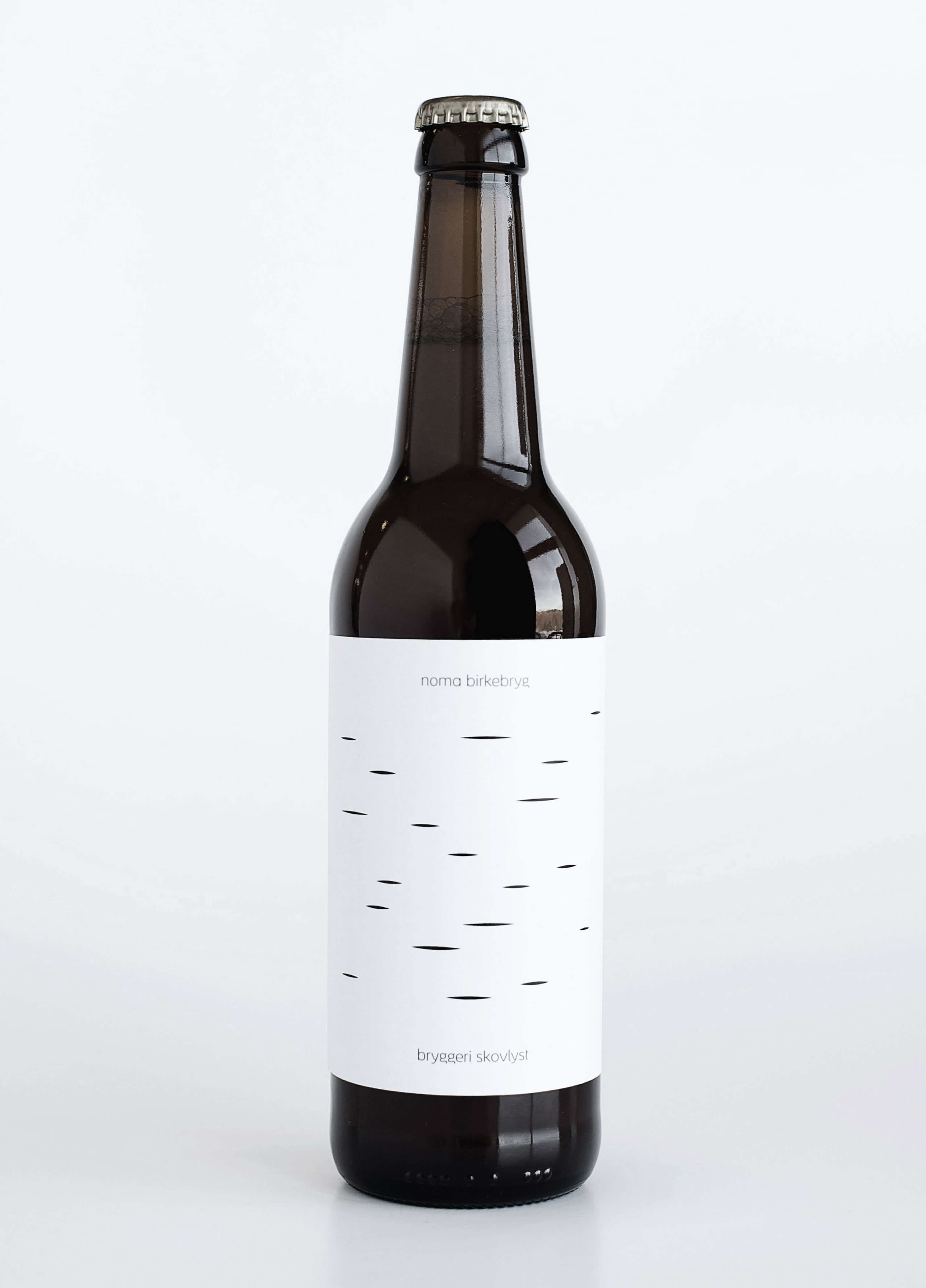 bottle with white label and black writing with white backdrop