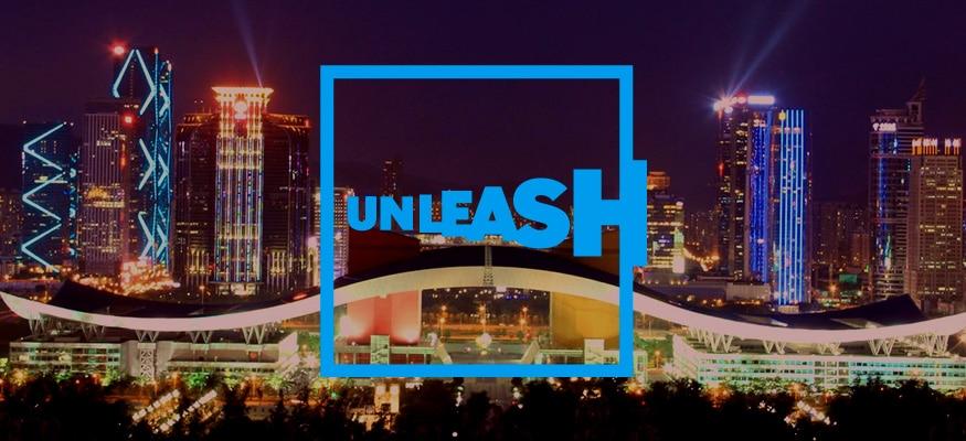 Blue logo saying UNLEASH on backdrop of Shenzhen city