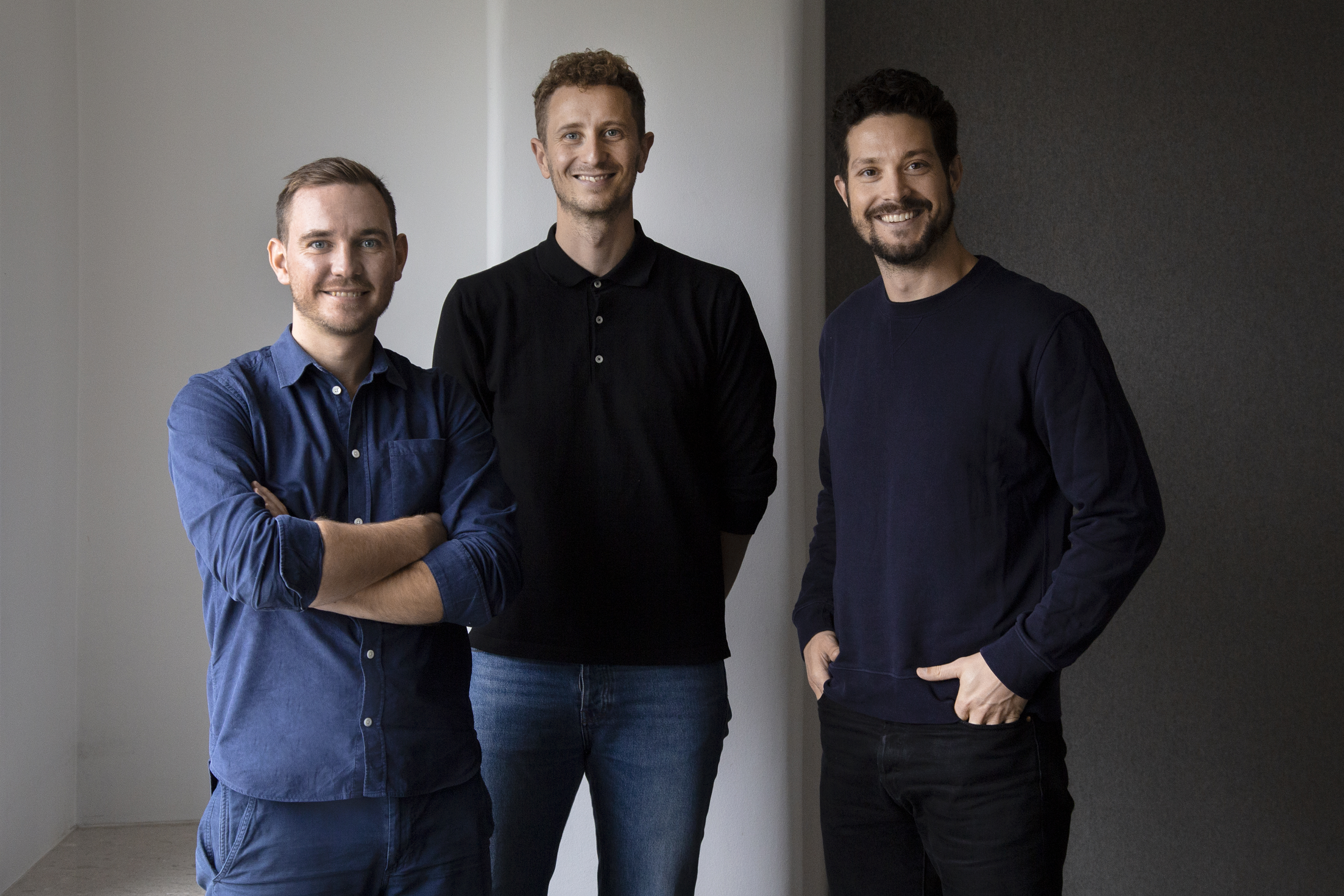 Three men from a design agency