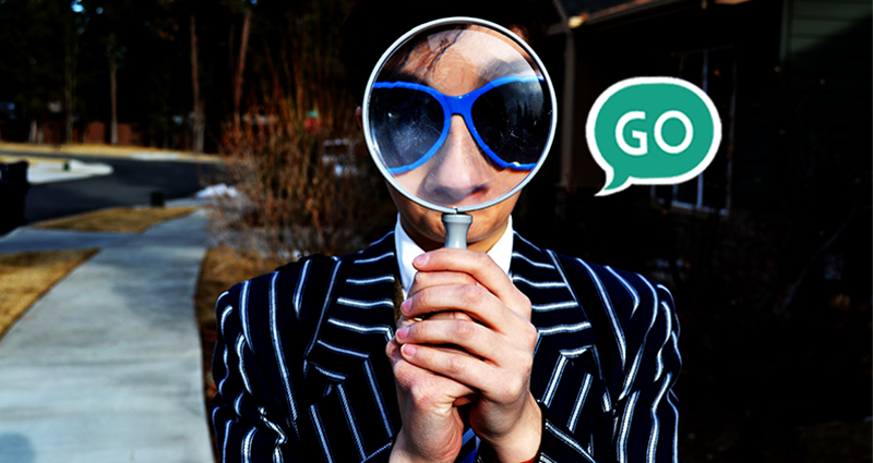 **Man with a magnifying glass.