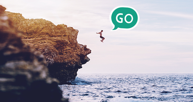"A man is jumping from the rock. Green speech bubble ""GO""."