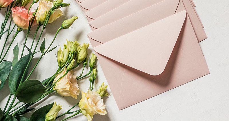 An alternative for email marketing - envelopes and flowers on the table
