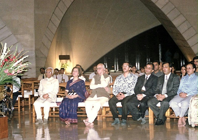 """India's Home Minister, Mr. L. K. Advani (third from left), and other guests listen to a choir service at the Baha'i House of Worship in New Delhi commemorating the Indian Army's """"Haifa Day"""" on 23 September 2000."""