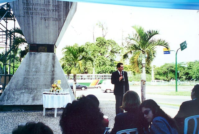 Mr. Iradj Roberto Eghrari speaking on behalf of the Brazilian Baha'i community at a ceremony to deposit soil samples from 26 nations in the hourglass-shaped Peace Monument in Rio de Janeiro.