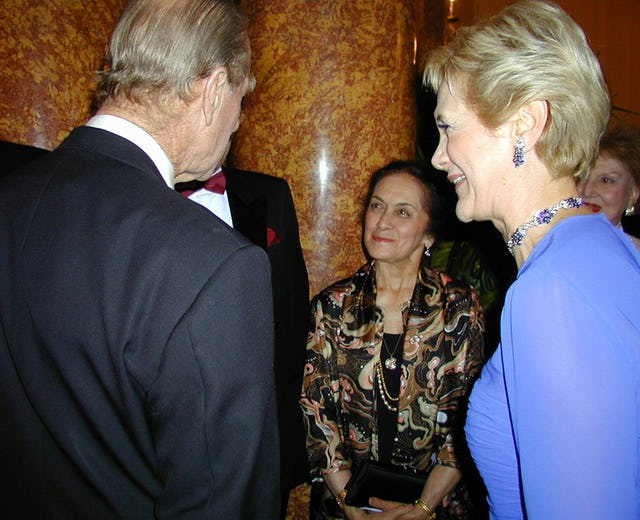 At a 15 May 2001 Arts for Nature event honoring Madame Ruhiyyih Rabbani in London, HRH Prince Philip, Duke of Edinburgh, left, talks with Ms. Violette Nahkjavani, center, in the presence of Ms. Guilda Navidi-Walker, right. Ms. Nakhjavani accompanied Madame Rabbani on her world travels and has recently written a book about her life. Ms. Navidi-Walker was convenor of the event.