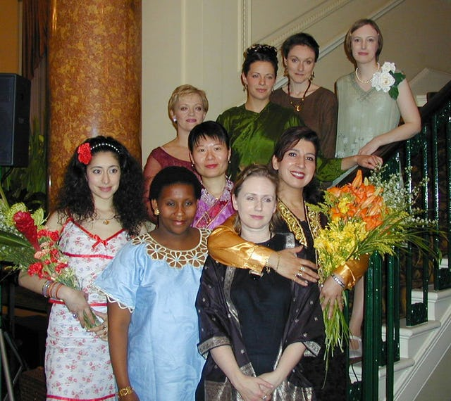 The cast of performers at an Arts for Nature tribute honoring Madame Ruhiyyih Rabbani, held 15 May 2001 in London at Canada House. The event featured not only a dramatic narrative produced especially for the occasion but also several musical numbers.
