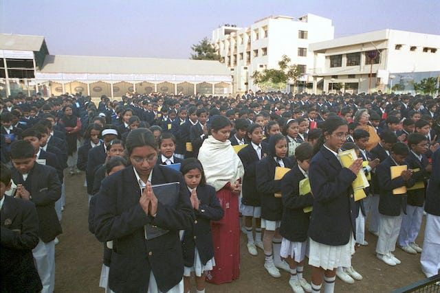 With an enrollment this year of more than 25,000 students, in grades ranging from pre-primary to college, City Montessori School nevertheless has a high academic reputation.| Shown here is morning assembly at the Gomti Nagar branch, one of 20 branches in Lucknow. Each branch is a small, self-contained campus, with about 1,250 students.