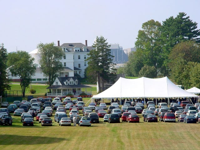 Hundreds attended the dedication of the new Harriet and Curtis Kelsey Center at Green Acre Baha'i School on 21 September 2002, which was held under a tent on the Green Acre grounds. In the background is the Sarah Farmer Inn, an historic building visited by Abdu'l-Baha.