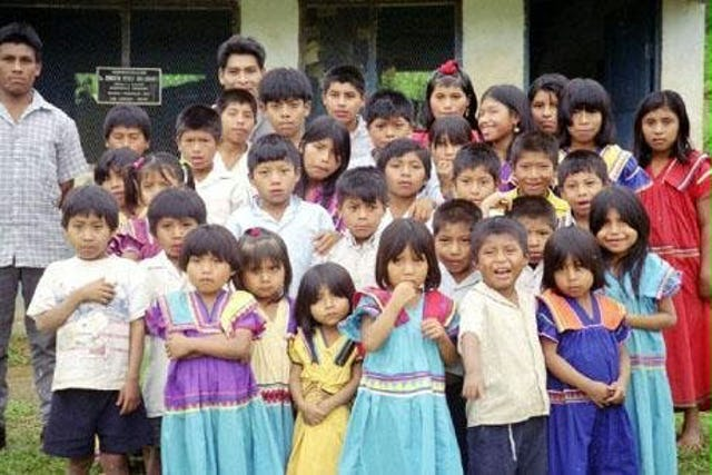 The students of the Baha'i school at Quebrada Venado in Western Panama. In the back row, at left, is Victorino Rodriguez, their teacher.