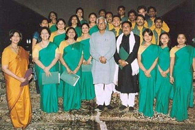 Defence Minister of India, Mr. George Fernandes (center left) with the choir at the Baha'i House of Worship, India.