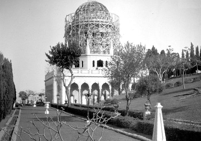 The dome and drum of the Shrine of the Bab take shape over the completed octagon and colonnade, 1952.