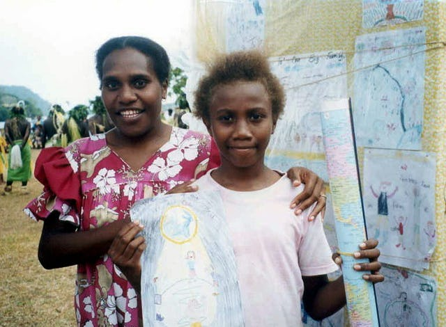 Stephanie Melenamu (right), one of three prizewinners in the jubilee poster competition with a member of the Baha'i National Education Committee, Annick Moltaban.