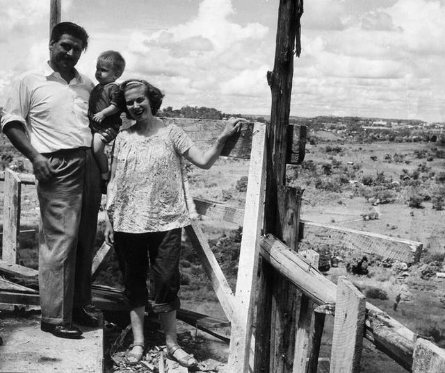 Mr. and Mrs. Hainsworth with their son, Richard, at the top of the Baha'i House of Worship in Kampala, Uganda, shorthly before it was completed in 1961. Mr. Hainsworth was one of the six Baha'is who founded the Baha'i community in Uganda in 1951.