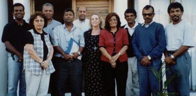 Members of the National Spiritual Assembly of Mauritius with Poova Murday, Knight of Baha'u'llah for Chagos (third from right), and his wife, Patricia Murday (fifth from right).