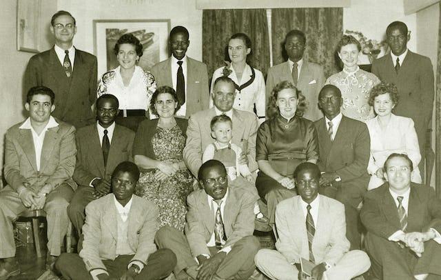 "(Front, left to right) Charles Zauyamakando, Dundusa Chisiza, Bernard Toni, Salvator (""Sue"") Benatar, (middle, left to right) Shidan Fat'he-Aazam, Willie Msarurwa, Claire Gung (Knight of Baha'u'llah), Larry Hautz with Denny Fat'he-Aazam, Helen Hope, Masten Mganhiri, Carol Hautz, (back, left to right) Melvin Hope, Sylvia Benatar, Isaac Kachuwendi, Joan Chalker, Moses Makwaya, Florence Fat'he-Aazam, Nathan Shamuyarira."
