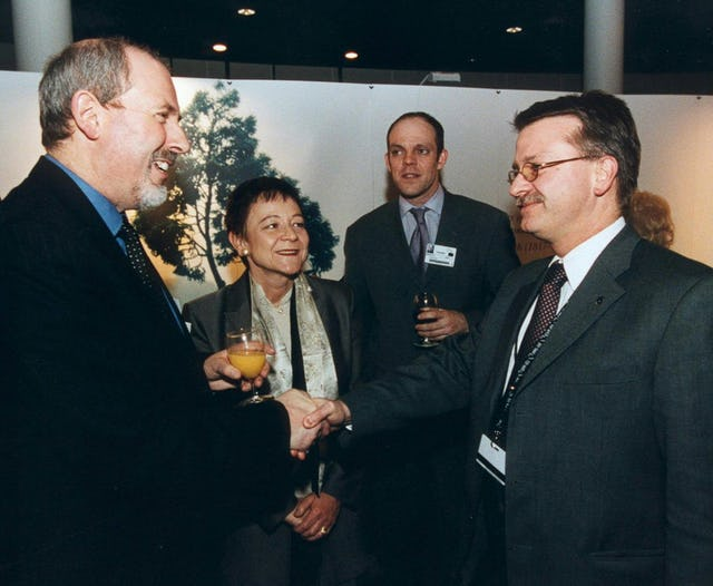 Baroness Ludford with Michael Gahler (right), a German member of the European Parliament, and Baha'i representatives Barney Leith (left) and Daniel Wheatley (second from right). Photo by European Parliament.