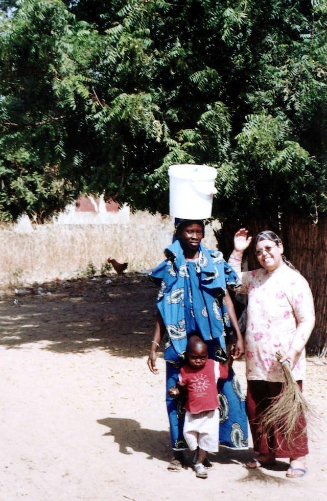 Baha'i traveling teacher Elbahi Aziza (right) visiting local Baha'is.
