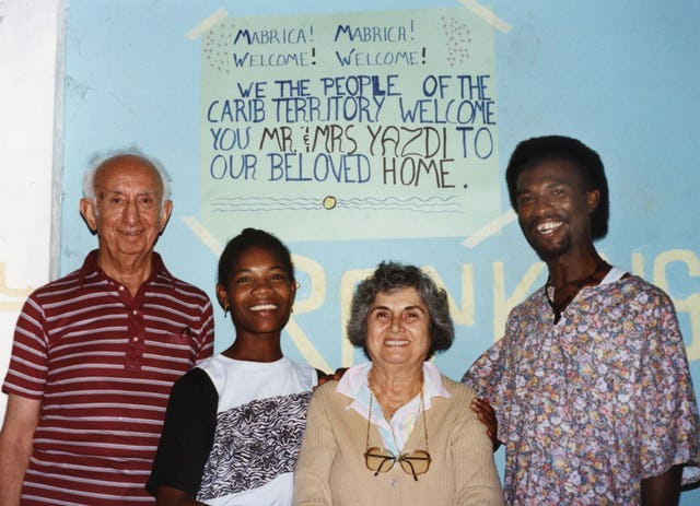 Aziz Yazdi (left) and Mrs. Yazdi (second from right) with Therese and James Elijio, Dominica, West Indies, 1991.