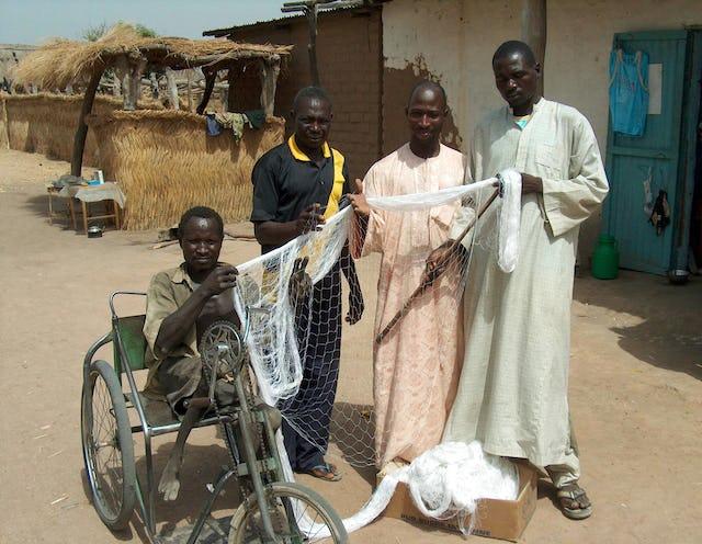Netmaker Ali Mahamat (third from left) with fishermen from Waltama.
