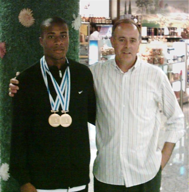 Nelson Evora with his coach, Joao Ganco.
