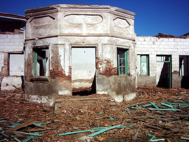 Under destruction...the houselike structure marking the resting place of Quddus, Babol, Iran, April 2004.