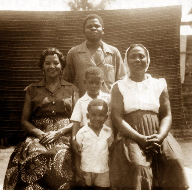 At the Tanyi residence, 1955: Vivian Wesson (left), David Tanyi (standing rear), Esther Tanyi (right), and the Tanyi children, Mbu and Enoch.