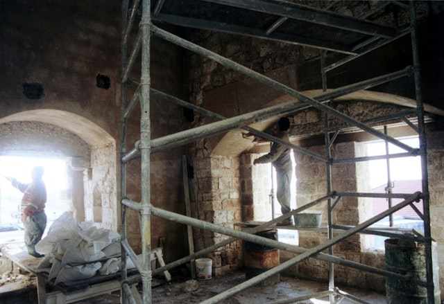 Restoration work under way in Baha'u'llah's cell.