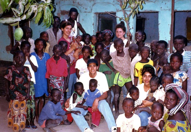Residents of the village of new Yundun in The Gambia with visiting Baha'is from Canada and the United States, who were contributing to children's classes and literacy classes. 1993.