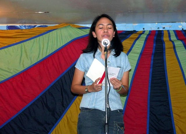 Bahiyyih Ancheta reading a poem at the Baha'i National Arts Festival in the Philippines.