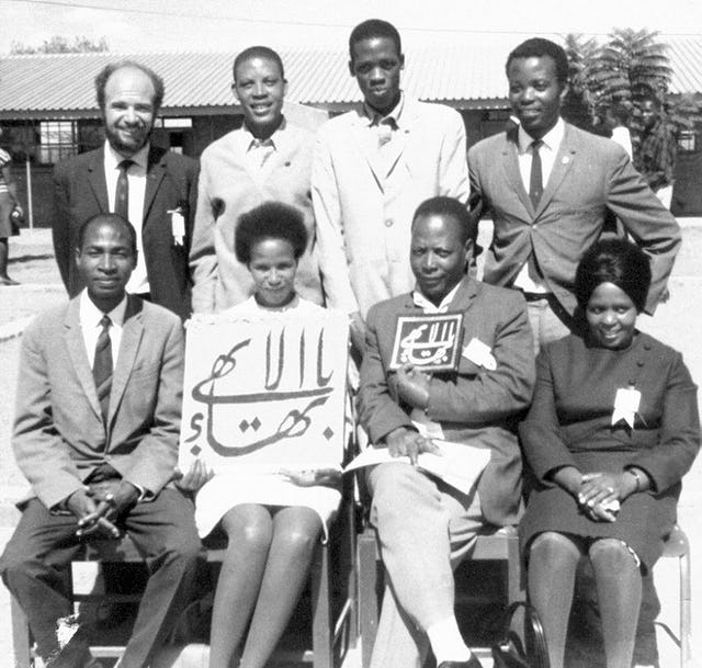 Eight members of the first National Spiritual Assembly of the Baha'is of Botswana, 1970.