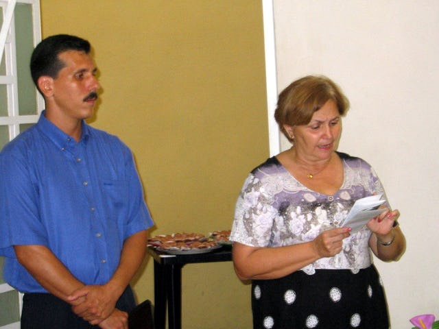 The chief of religious affairs in the Cuban government, Caridad Diego Bello, addresses the interreligious gathering held at the national Baha'i center on 23 May 2005. At left is the secretary of the Local Spiritual Assembly of the Baha'is of Havana, Ernesto Santirso.
