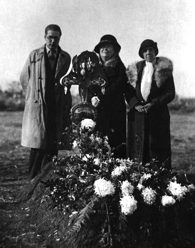 At the grave of George Adam Benke in 1932...Hand of the Cause of God Martha Root (1872-1939), right, Marion Jack (center), and an unknown mourner.