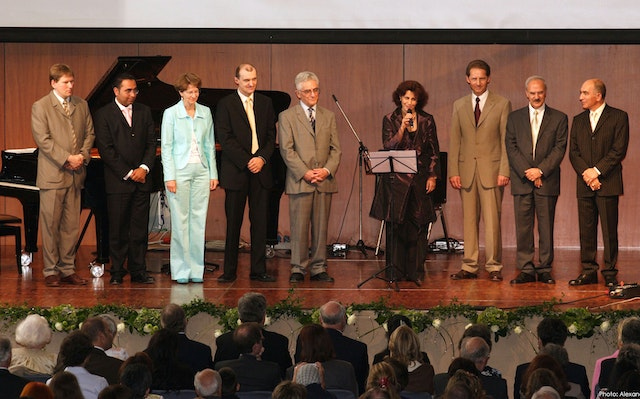 The nine members of the National Spiritual Assembly of the Baha'is of Germany, the community's elected national governing council, addressed the jubilee gathering as a corporate body.