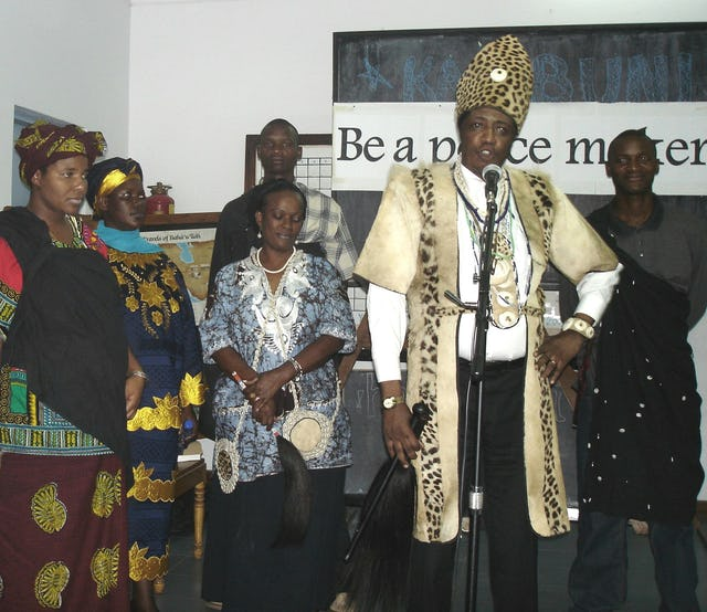 Chief Matange (second from right) and other members of an African traditional religion during prayers at the International Day of Peace gathering organized by the Baha'i community of Tanzania.