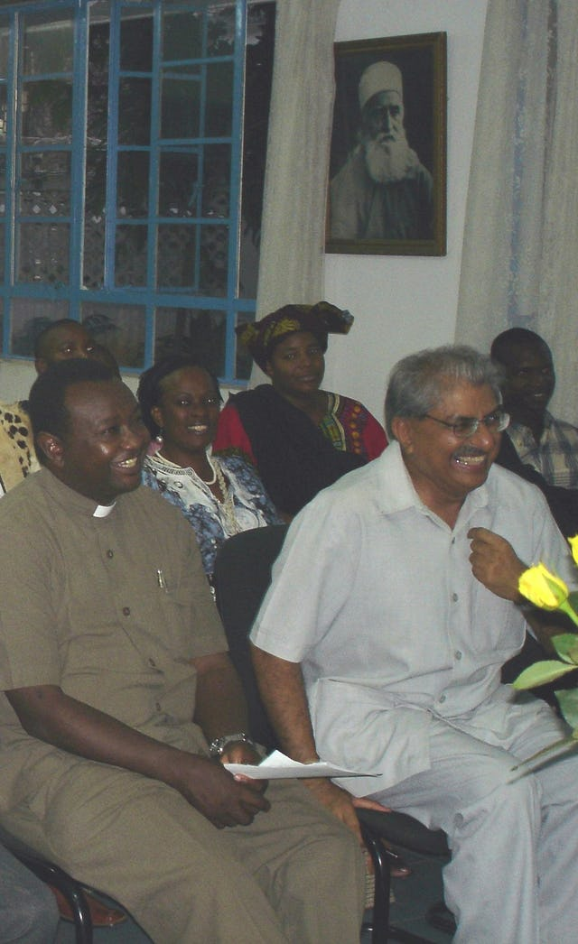 A lighthearted moment during discussions at the International Day of Peace gathering organised by the Baha'is of Tanzania.(Front row) Secretary of interrelations dialogue of the Catholic Church Rev. Father Gallus Marandu (left), Aga Khan Council representative Dr Navruz Lakhani.