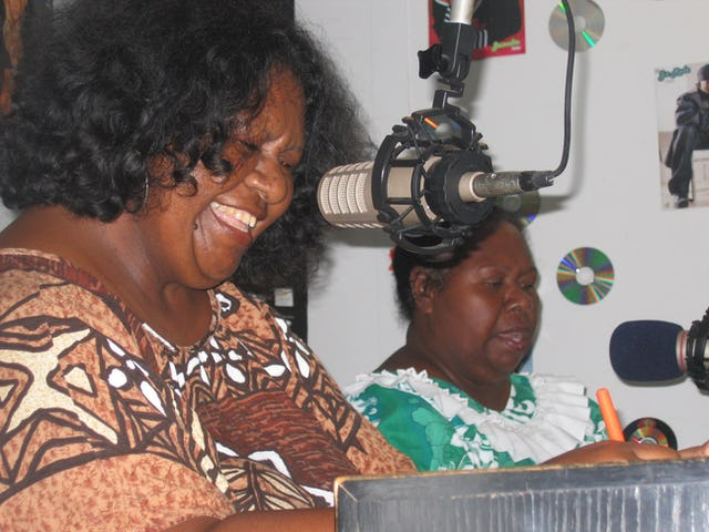 Janelle Gebadi (left) and Ina Aiputa presenting their weekly Baha'i-inspired radio program.