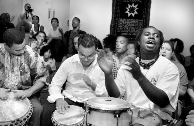 Drummers send out energy and inspiration during a Hush Harbor devotional meeting at the New York Baha'i Center. (Photograph by Mike Relph)