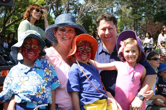 Angela and Gary Cowan of Gosford with their children during face-painting and other recreational activities held in the grounds of the National Baha'i Centre adjacent to the House of Worship after the children's service.