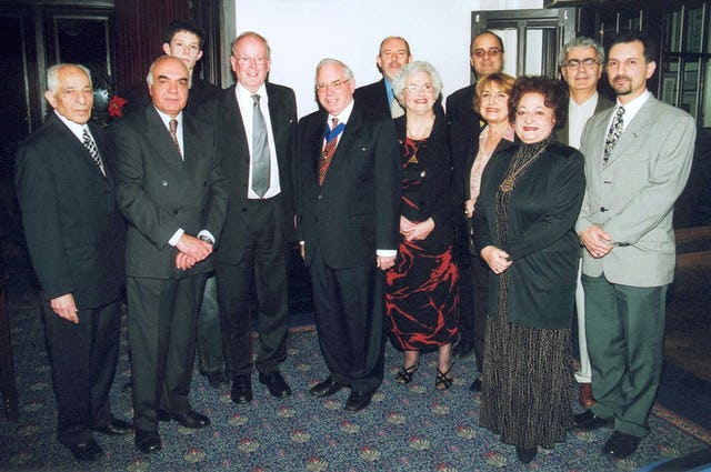 Sir Sydney Chapman (fourth from left) and Barnet Deputy Mayor Victor Lyon and Mrs. Lyon (fifth and seventh from left) with others at the award ceremony.