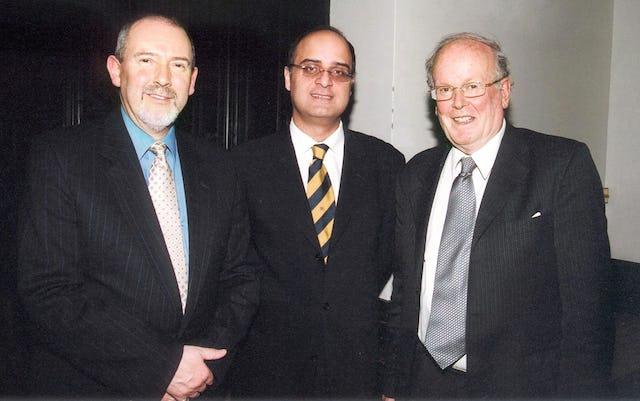 Blomfield Award recipient Sir Sydney Chapman, right, with Baha'i representatives, the Hon. Barney Leith (left) and Dr. Kishan Manocha.