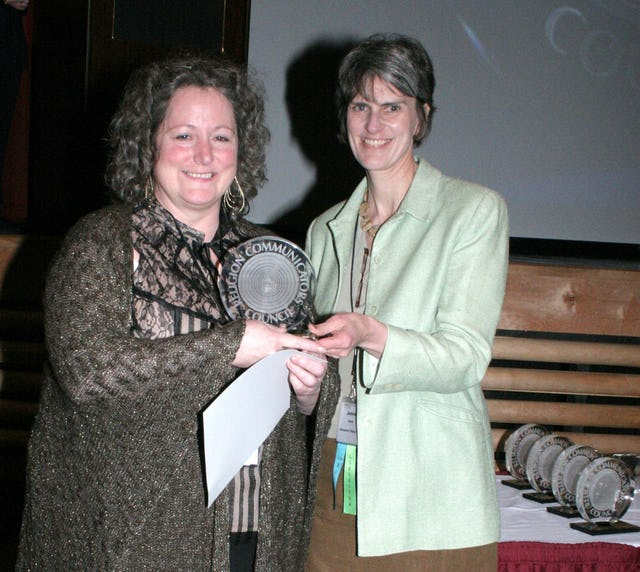 """Patricia Tomarelli, shown at left, receiving a """"Best of Class"""" DeRose-Hinkhouse Award for """"Sarah Farmer's Dream of Peace"""" in the """"public relations materials"""" category, for special issue publications. Presenting the award, at right, is Jeanean Merkel, President of the Religion Communicators Council (RCC)."""