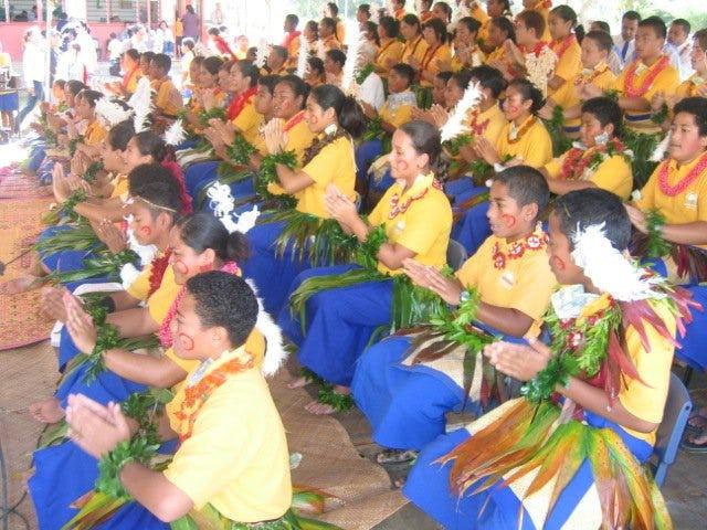 High school students performing the Ma'ulu'ulu traditional dance.