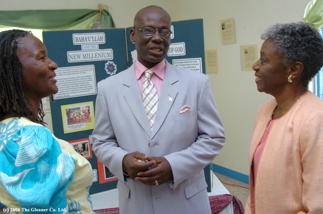 The mayor with Ms. Aisha Mulende (left) from the Buddhist community, and Ms. Whyte.