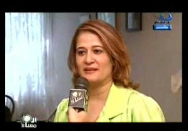 Dr. Basma Moussa is shown here in a televised interview on Egypt's Dream-2 TV channel, aired on 13 August 2006, about her her testimony before the National Council for Human Rights on 8 August 2006 in Cairo. Dr. Moussa presented the Baha'i point of view on the national identificaton card controversy to the Council.
