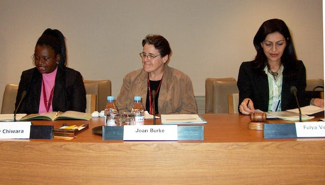 Letty Chiwara, Joan Burke, and Fulya Vekiloglu, left to right, on 8 September 2006 at the United Nations. Ms. Chiware is a program specialist with the Africa section of the United Nations Fund for Women (UNIFEM), Ms. Burke is a Catholic nun who lived and worked in various countries in Africa for 20 years, and Ms. Vekiloglu is a representative of the Baha'i International Community to the United Nations.